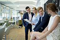 Confident business team in office - WESTF021607