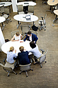 Businesspeople having a meeting in office - WESTF021625