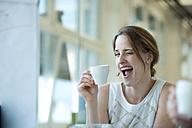 Portrait of playful businesswoman winking - WESTF021640