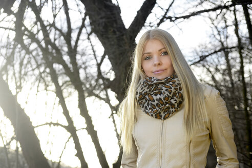 Portrait of smiling blond woman in nature - BFRF001695