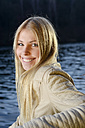 Portrait of relaxed blond woman in front of a lake - BFRF001704