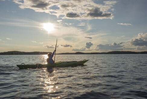 Finland, Southern Savonia, Oravi, Linnansaari National Park, boy kayaking on Lake Haukivesi - JBF000266