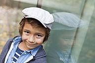 Portrait of smiling little boy wearing cap - VABF000018