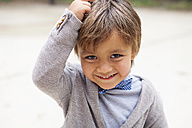 Portrait of smiling little boy with hand on his head - VABF000024