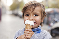 Portrait of happy little boy with ice cream cone - VABF000030