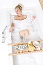 Woman enjoying a bubble bath - MAEF011098