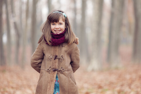 Young girl, brown coat in park, autum, smiling - XCF000046
