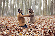 Father playing with his daughter in park, autumn - XCF000049
