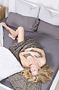 Blond woman lying in bed - MAEF011141