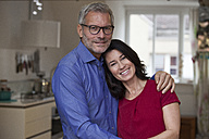 Portrait of smiling mature couple at home - RBF003649