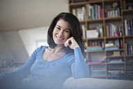 Portrait of smiling relaxed woman at home - RBF003655