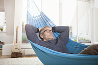 Mature man at home sleeping in hammock - RBF003676