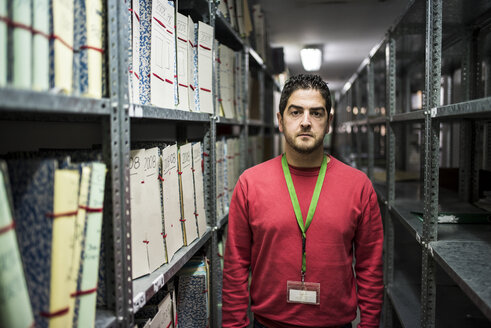 Portrait of serious looking man in an archive - JASF000314