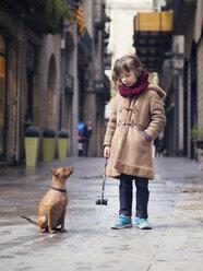 Spain, Girona, portrait of little girl and her Miniature Pinscher - XCF000054