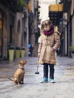 Spain, Girona, portrait of little girl and her Miniature Pinscher - XCF000054