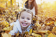 Happy girl in autumn leaves - HAPF000060