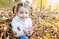 Happy girl in autumn leaves - HAPF000063