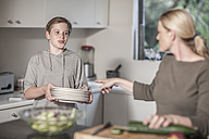 Mother and son preparing food - ZEF007691