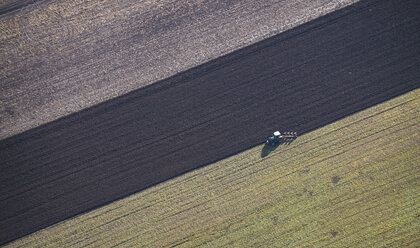 Austria, tractor on field, aerial view - STCF000103