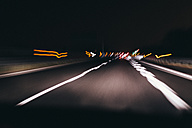 Italy, Udine, driving at night along the highway - MAUF000162