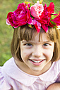 Portrait of smiling little girl wearing flowers - LVF004332