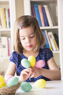 Portrait of little girl playing with Easter eggs - LVF004338