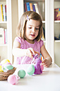 Little girl playing with Easter eggs and Easter bunny - LVF004341