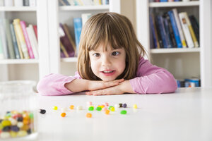 Portrait of little girl with jelly beans - LVF004344