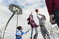 Young men playing basketball - UUF006275
