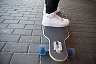 Man's feet on a longboard, close-up - ERLF000097