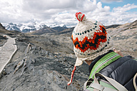 Traveler wearing a wool chullo in the Cordillera Blanca, part of the Andes mountain range - GEMF000587