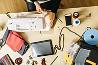 Young fashion designer working in her studio - JRFF000263