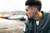 Profile of a stylish young man - MGOF001218