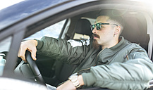 Young man driving a car - MGOF001221