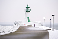 Germany, Mecklenburg-Western Pomerania, Ruegen, Sassnitz, Lighthouse in winter - ASCF000438