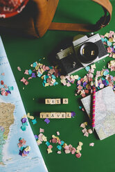 Map next to a camera, a travel bag and a notebook with a funny llama pen - GEM000595