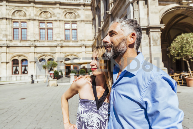 Austria, Vienna, smiling couple in front of state opera - AIF000164