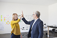 Businessman and coworker giving high five - RBF003958