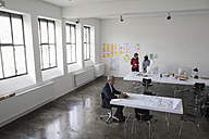 Architects working in office - RBF003985