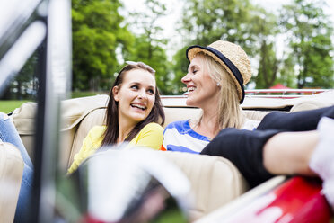 Two happy young women in a convertible - DAWF000450