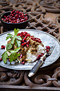 Metal plate of Khoresht Fesenjaan garnished with pomegranate seed - SBDF002615
