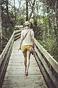USA, Florida, Fort Myers, Six Mile Cypress Slough Preserve, woman on boardwalk - CHPF000185