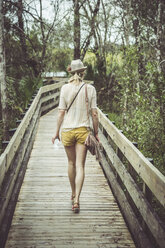 USA, Florida, Fort Myers, Six Mile Cypress Slough Preserve, woman on boardwalk - CHPF000185