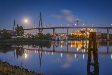 Germany, Hamburg, Koehlbrand Bridge and full moon at night - NKF000424