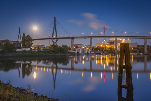 Germany, Hamburg, Koehlbrand Bridge and full moon at night - NKF000424