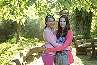Portrait of mother and daughter hugging each other in nature - LBF001345