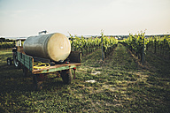 Austria, Weinviertel, tractor with tank of pesticide parking at vineyard - AIF000194