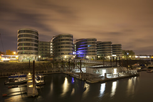 Germany, North Rhine-Westphalia, Duisburg, Inner harbour and office buildings at night - WIF003081
