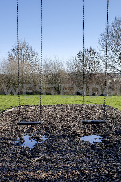 Two empts swings at playground - HLF000940