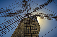 Spain, Mallorca, Manacor, wind mill against the sun - MHF000372